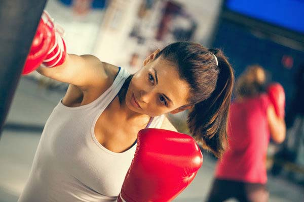 a young female practicing boxing